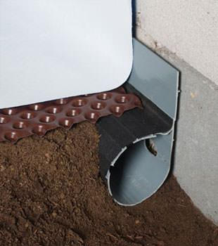 Closeup of a crawl space drainage system installed in Manassas