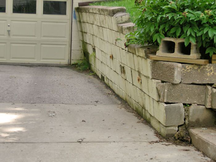 a failing retaining wall around a driveway in Washington D.C.